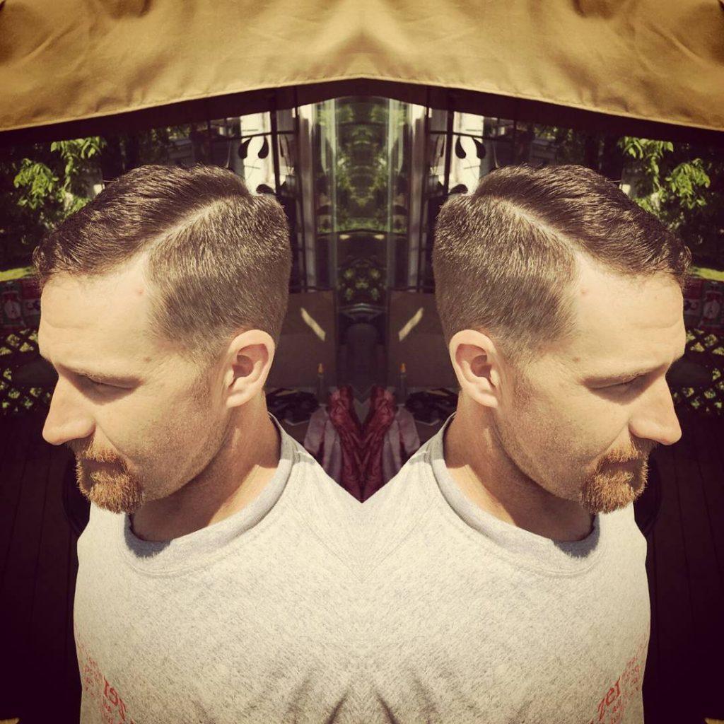 new haircut and a hard part