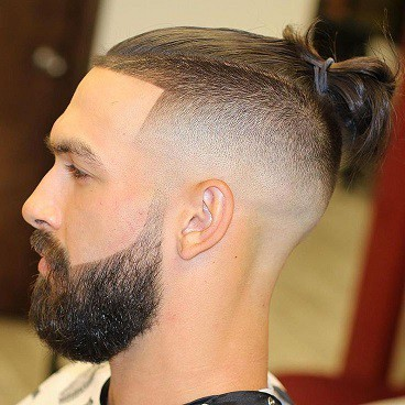 Hairstyle with Bun and Sides Shaved