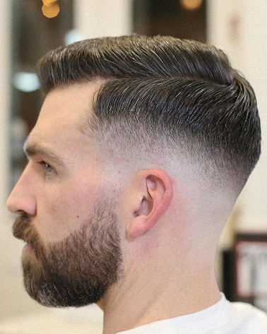 Parted Hair With A Tapered Comb Over