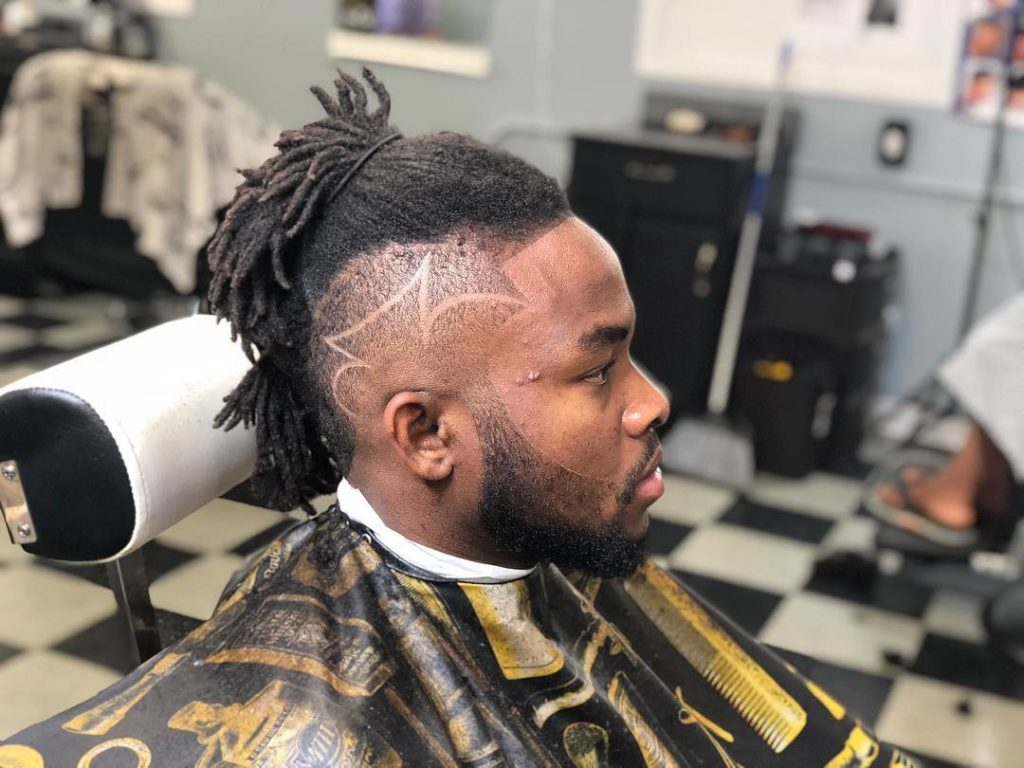 Long Hairstyles for Black men - Bun on top Look