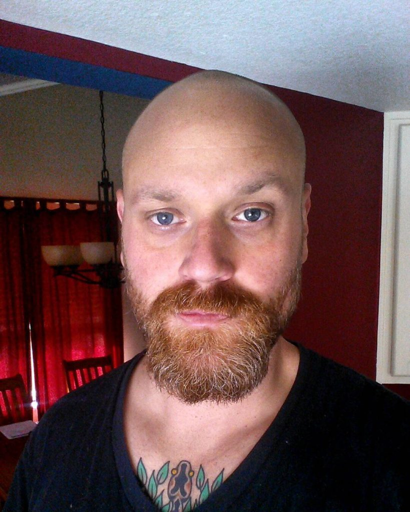 Ginger beard with a bald head