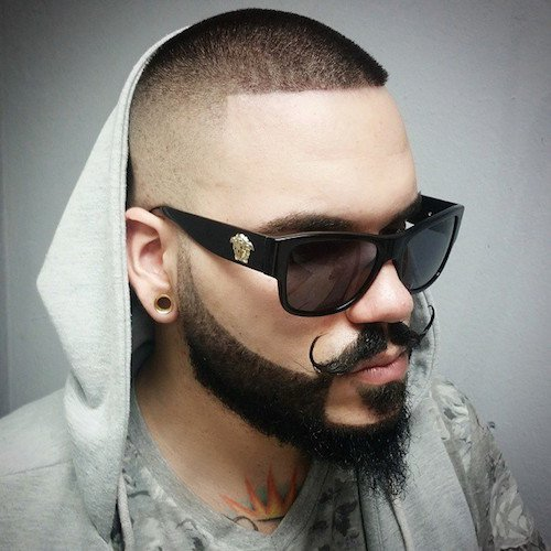 Fade up bald top with designed beard