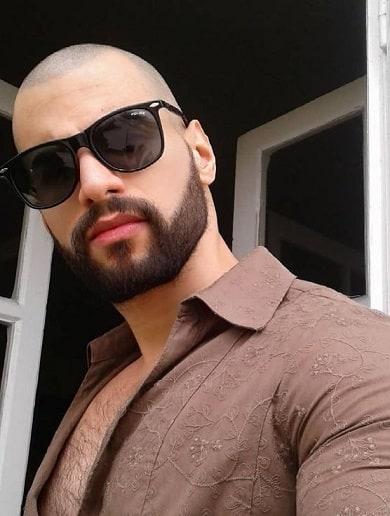 Fade up bald top with designed beard