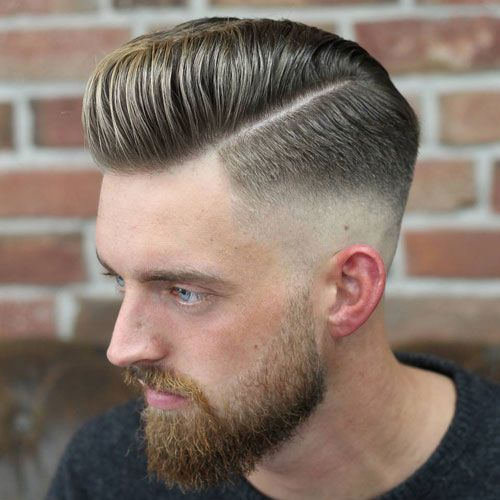 Medium pompadour mid fade with a side part