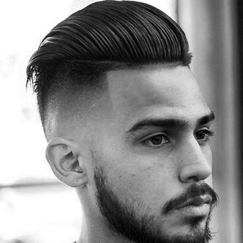 High skin fade with long hair slicked at back