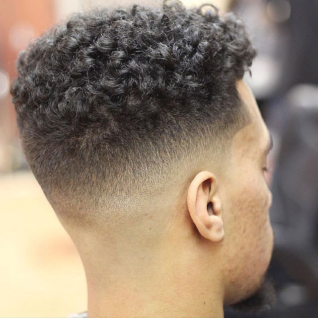 Mid fade with curls on top