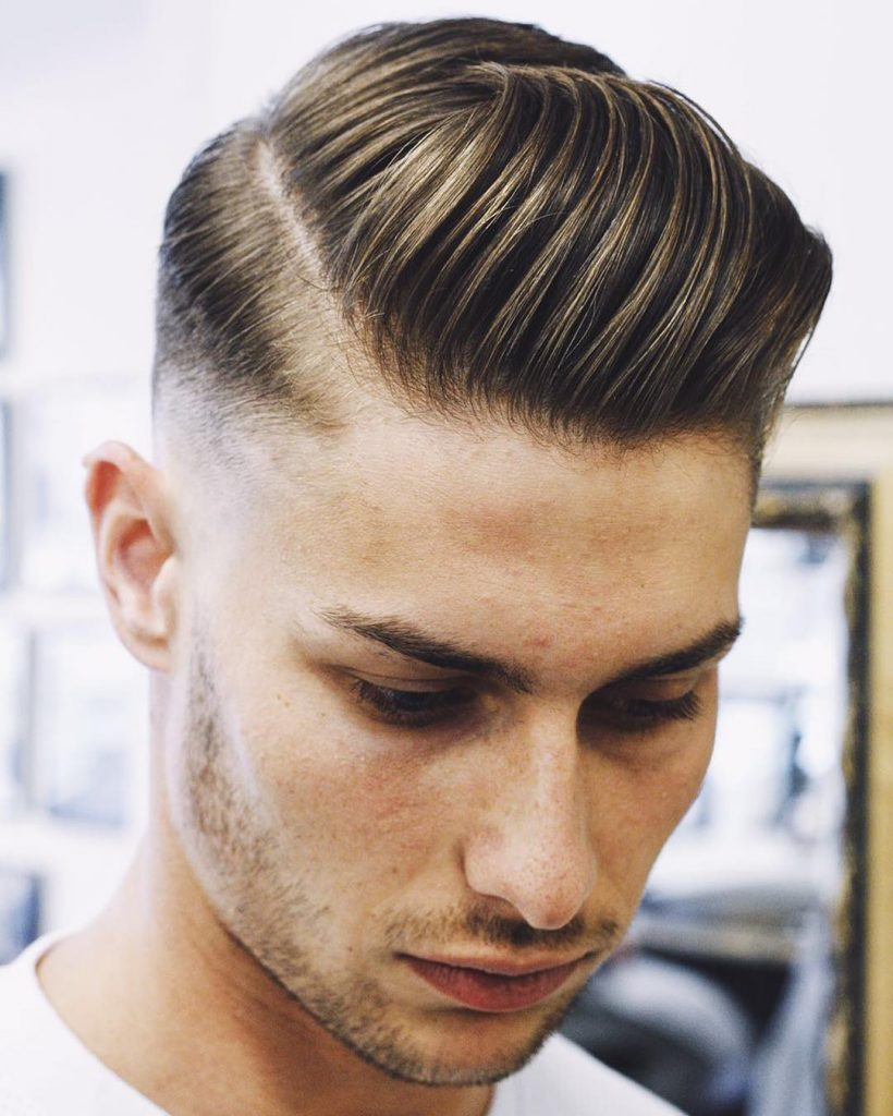 Mid fade with a modern pompadour