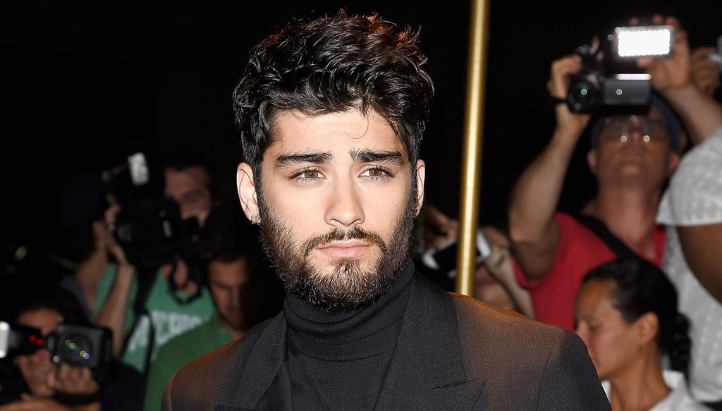 The wavy hairstyle with beard