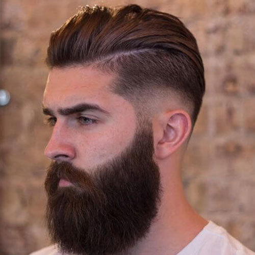 Mid fade brushed backed hair with beard