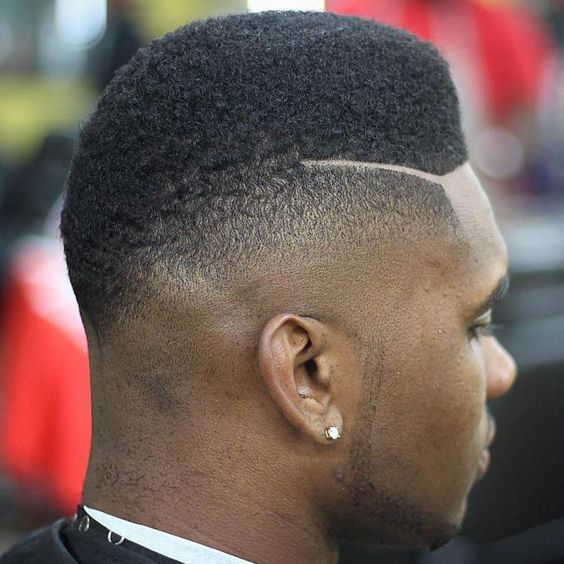 High fade with curls on the top