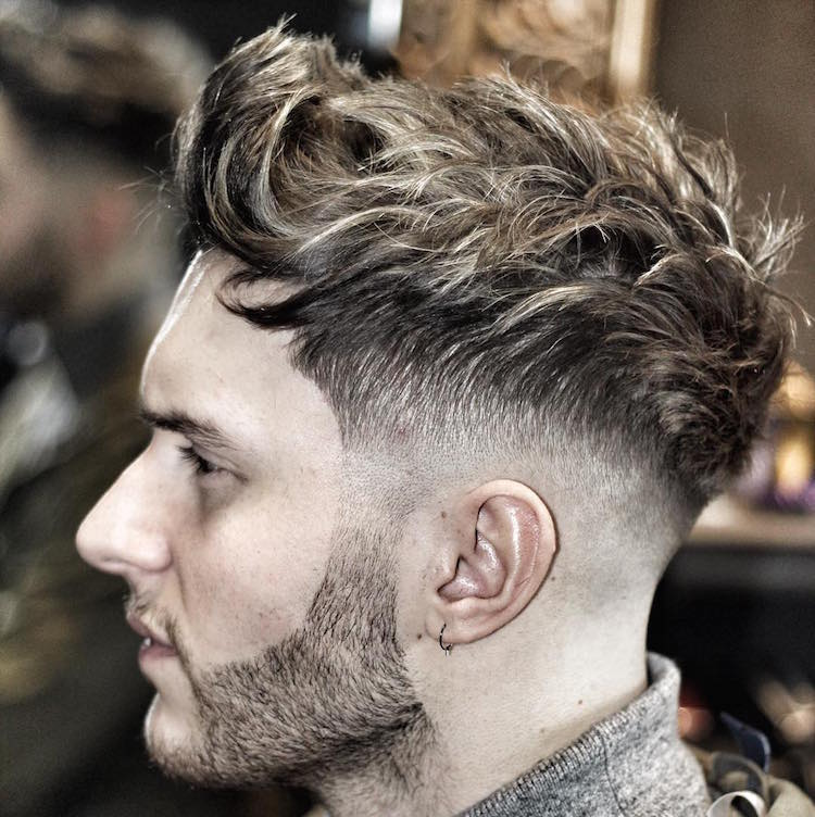 Disheveled look with a mid fade