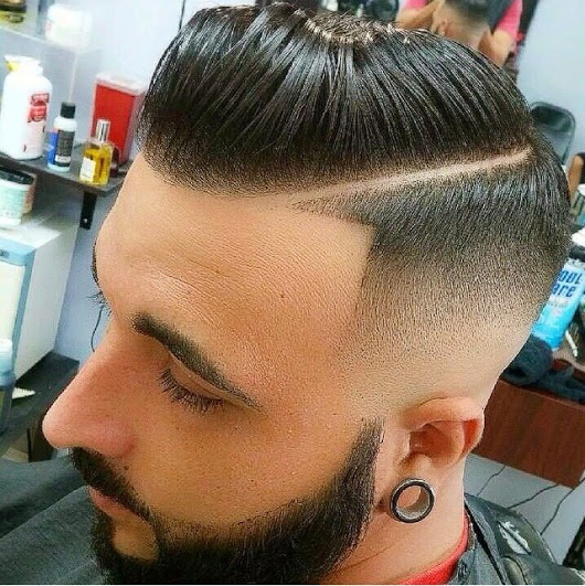Pompadour with a side part and faded side