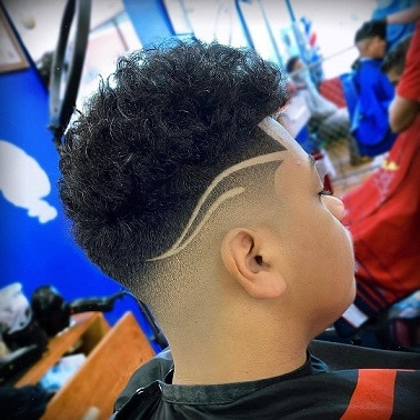 Designer low fade with long hair on top