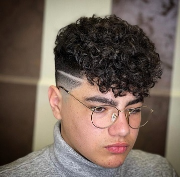Low fade curly hair with long fringes
