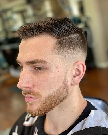 Mid bald fade with hard side parting