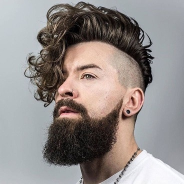 Mid fade with hair swept at a side