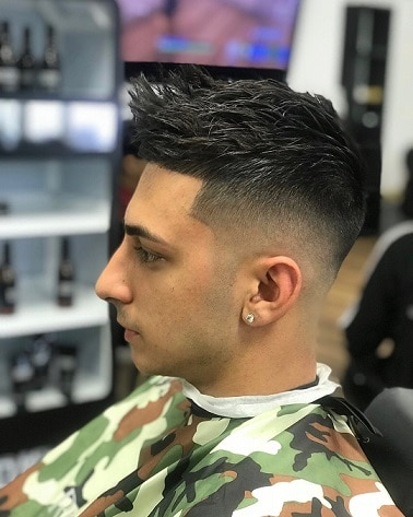 Mid fade with quiffs