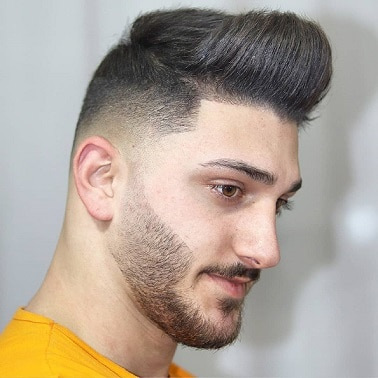 The low taper fade haircut with Pompadour