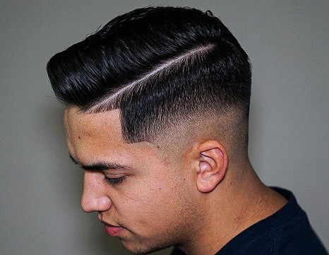 The low taper fade with a side part