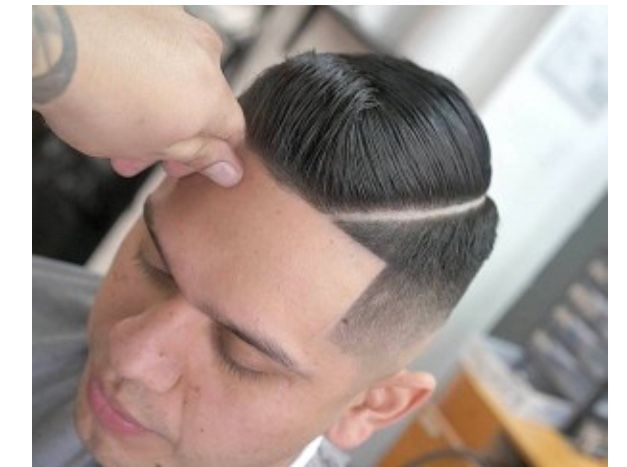 Short and slicked pompadour with a hard part