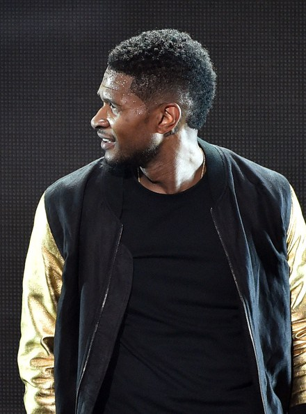 The curly Buzz with Burst Fade Usher Hairstyle