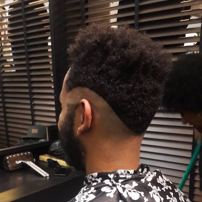 The Afro Style Rolling V Shaped Haircut