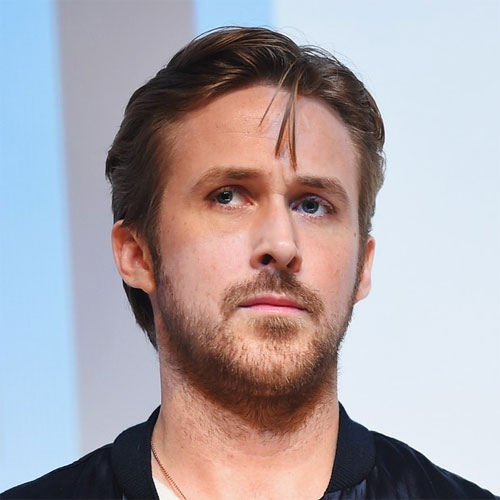 Ryan Gosling Hairstyle with Mid Part and Full Beard