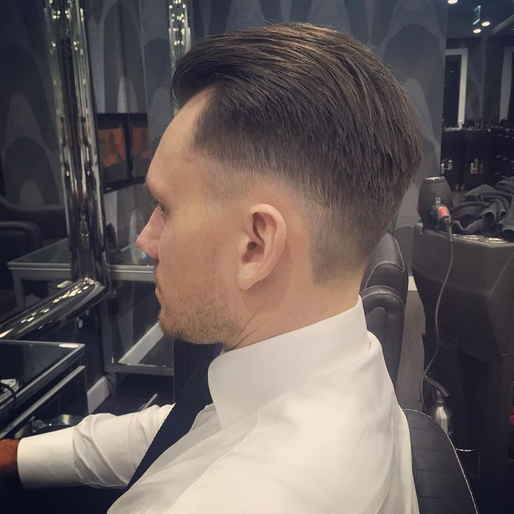 Low Bald Fade Slicked Back Hairstyle