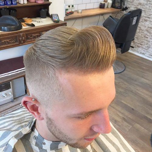 Roll back shaved pompadour with skin fade sides