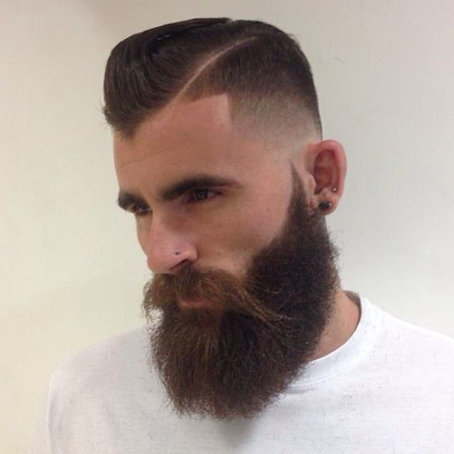 Creative shape up haircut with a full beard