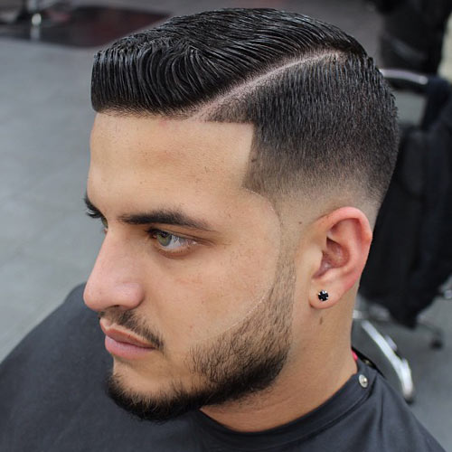 Shaping up fade with sideburns