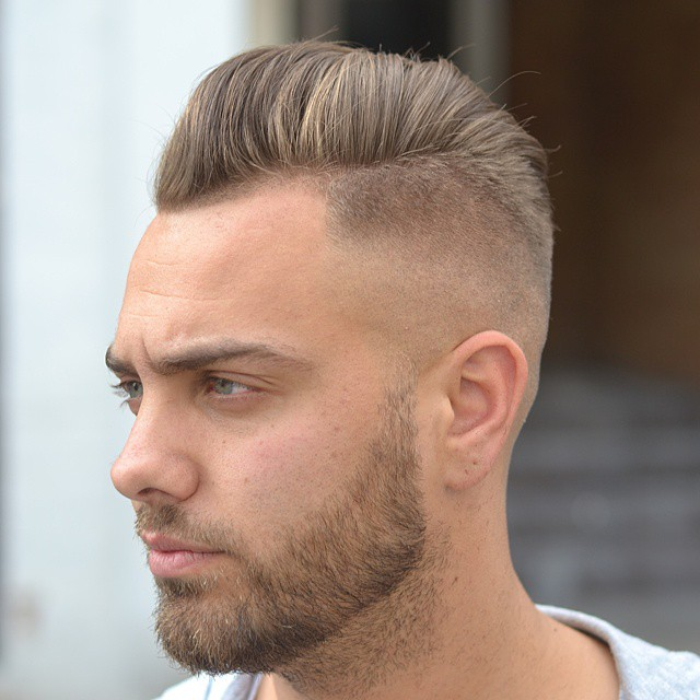 Skin fade medium length pompadour