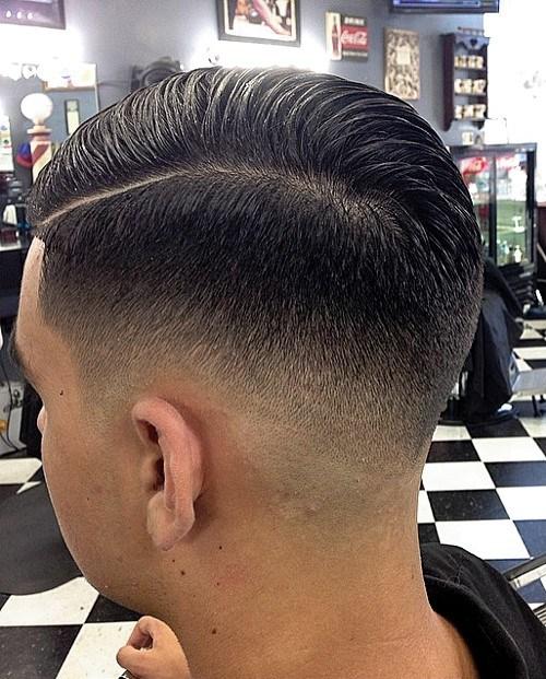 Coiffe professionnelle avec une partie latérale dégarnie. coiffure