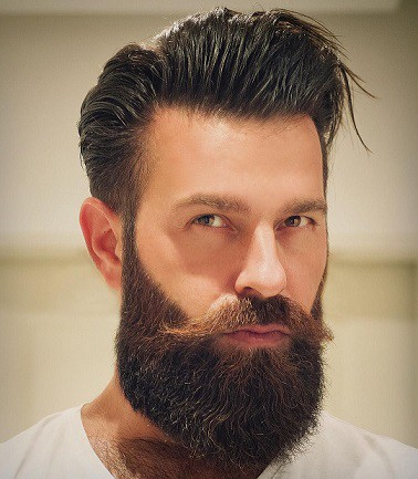 brown and bristly beard with neat mustache