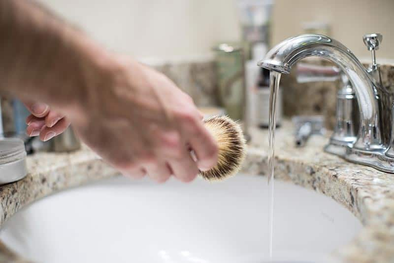 Clean your shaving brush with hot water