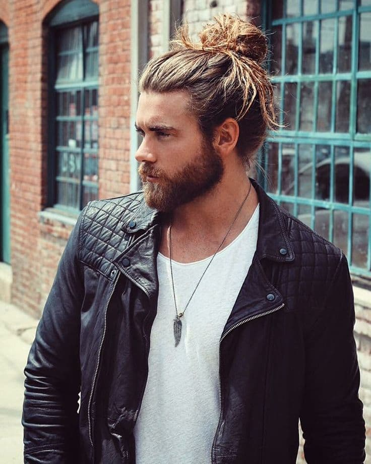 Man-bun with a dense beard