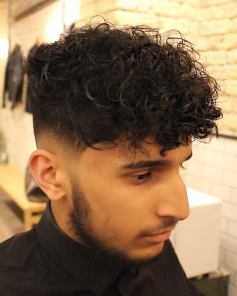 Cropped Curly Hair and Undercut