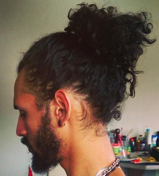 Curly hair with a man bun